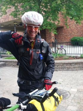 Chris Schuler of Switzerland preps for a ride in the rain as he leaves Whitefish as part of the Tour Divide race from Canada to Mexico.
