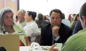 Governor Steve Bullock listens in at an economic round table discussion in Kalispell recently as part of the Main Street Montana Project.