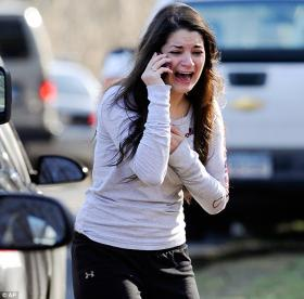 Carlee Soto's 27-year-old sister Victoria was one of the 26 teachers and students massacred at Sandy Hook elementary school last December - and this photo of Carlee learning the tragic news became one of the iconic photos of that tragedy.