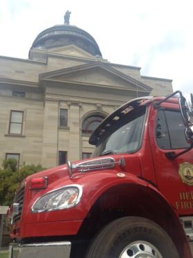 A Helena Fire Department engine is parked outside the Montana Capitol Wednesday afternoon after the building was evacuated.