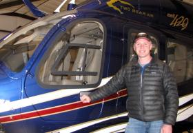 Jordan White of Two Bear Air stands next to the organizations new Bell 429 rescue helicopter.