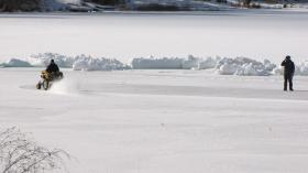 Workers prep the rink for Kalispell's first annual Pond Hockey Classic on Foys Lake.