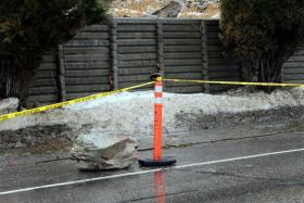large boulder that rolled off Mount Sentinel onto Campus Drive behind UM