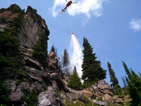 Helicopter suppression effort on the Hay Creek Fire Complex.