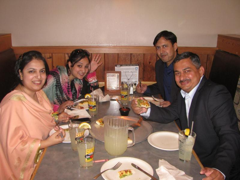 Four of the Pakistanis eating at Helena's MacKenzie River Pizza