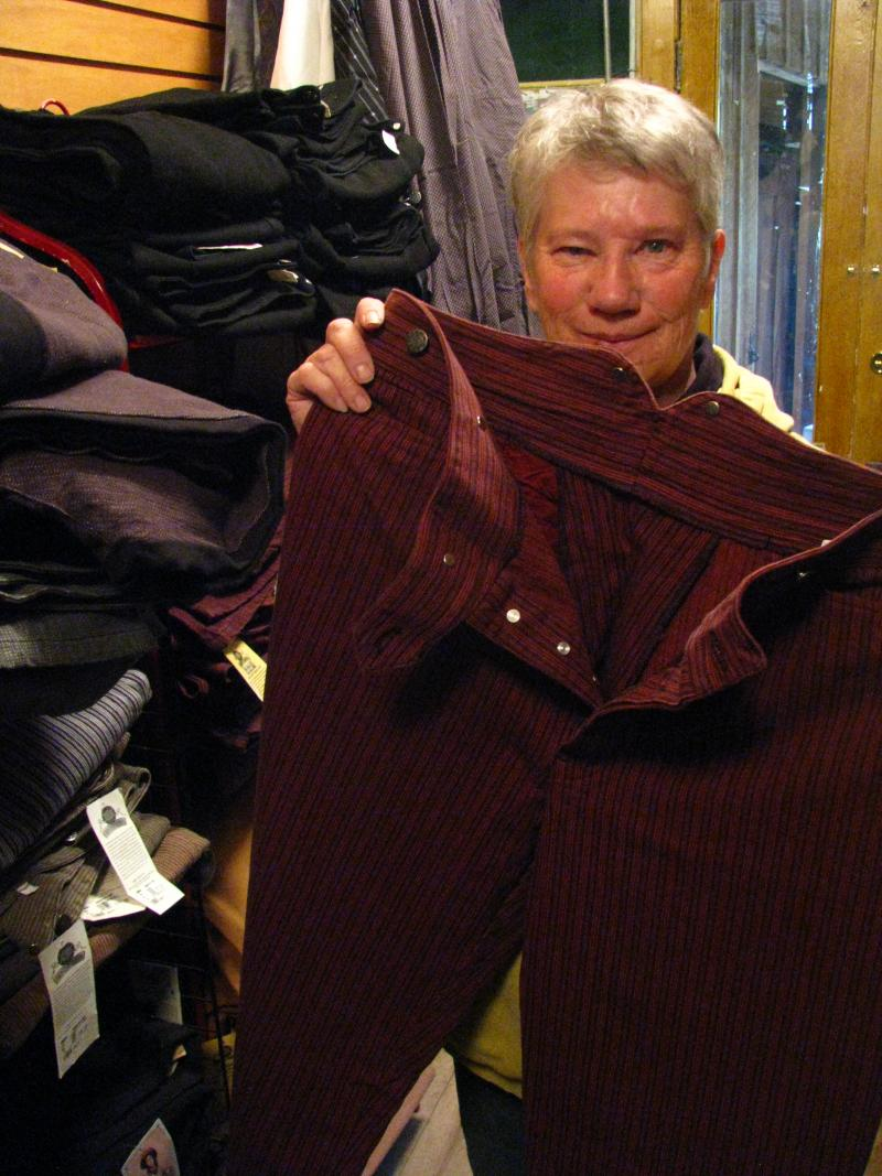 Ranks Mercantile owner Toni James shows off her store's 'frontier pants'