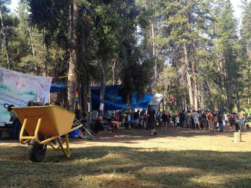 People gather for breakfast around 'Kid Village' at the Rainbow Family Gathering