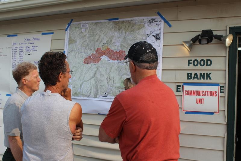 Evacuees looking at new map of fire's spread