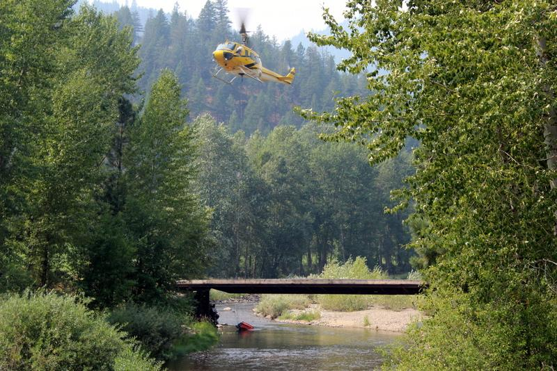 Helicopter dipping out of Lolo Creek
