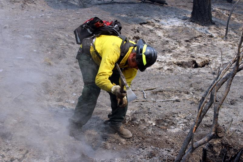 Whitefish firefighter Chad Malcott digging out hot spots