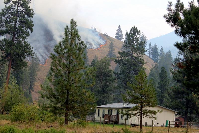 Fire creeping down toward homes along Highway 12