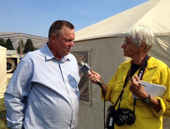 Sally Mauk interviewing Senator Tester in fire camp