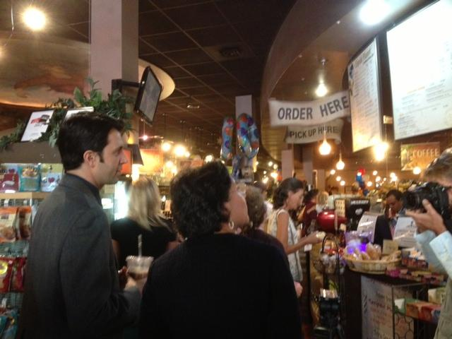Commerce Secretary Penny Pritzker in line to order a coffee at Liquid Planet