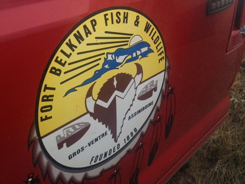 The Ft. Belknap Fish and Wildlife logo painted on the side of Azure's truck