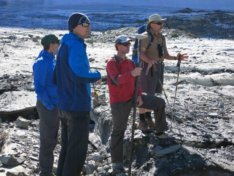 Dan Fagre, far right, and his research crew discuss survey methods on Grinnell Glacier.