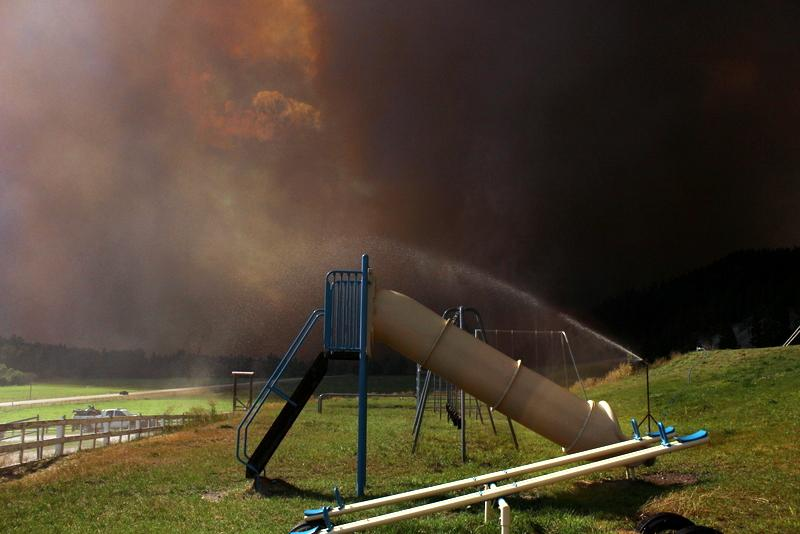 Lolo Creek Complex burning near grounds of Woodman school