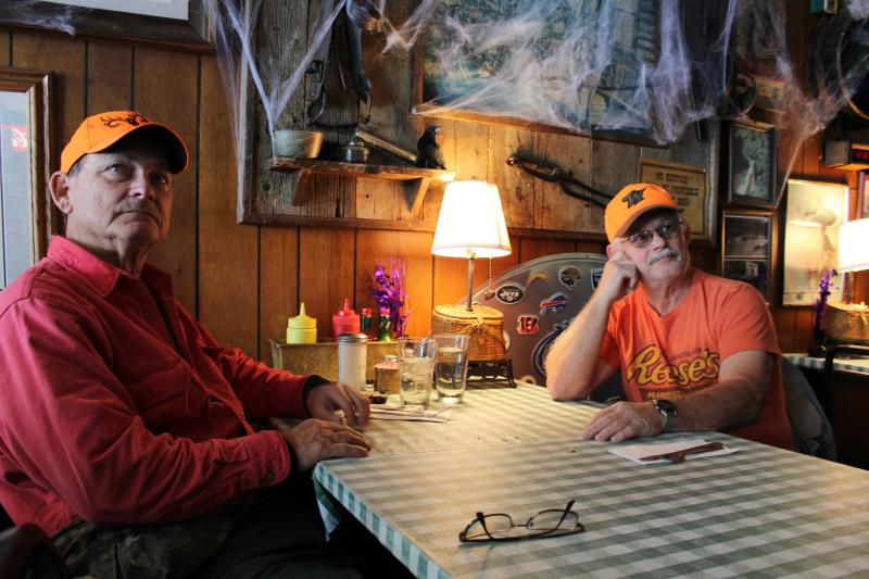 Brothers Gene and Ed Curtis are visiting Wolf Creek from California to hunt. They are skeptical about the idea of the resort tax.