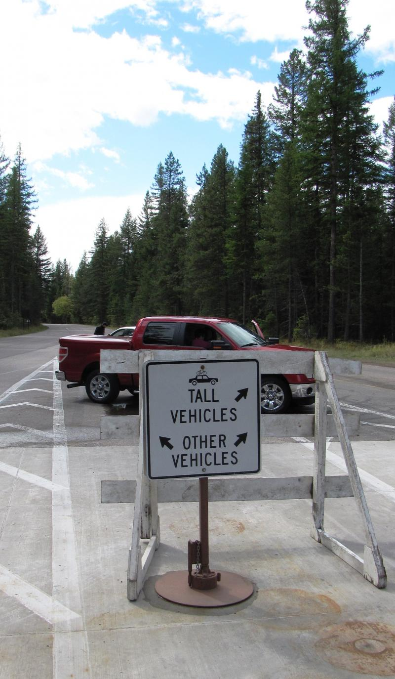 Disappointed visitors turn around at closed Glacier Park entrance.
