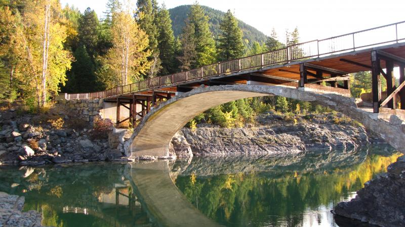 You can walk on the old West Glacier bridge, but a rope on the Park side of the Middle Fork Flathead River blocks access to the path running along the river.