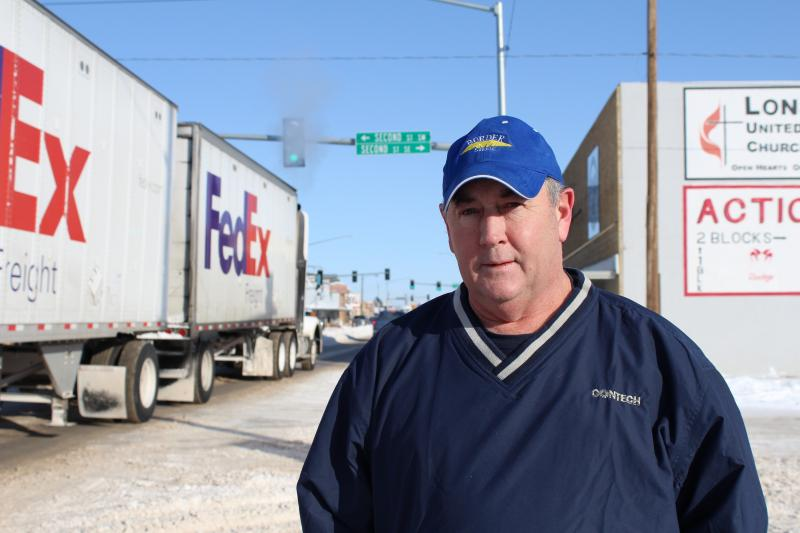 Sidney Mayor Bret Smelser stands out on the sidewalk of Central Avenue, which has seen a dramatic increase in truck traffic the last few years.