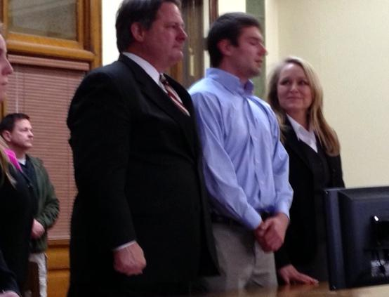 Jordan Johnson (center) flanked by his attorneys David Paoli and Kirstin Pabst at his sexual assault trial
