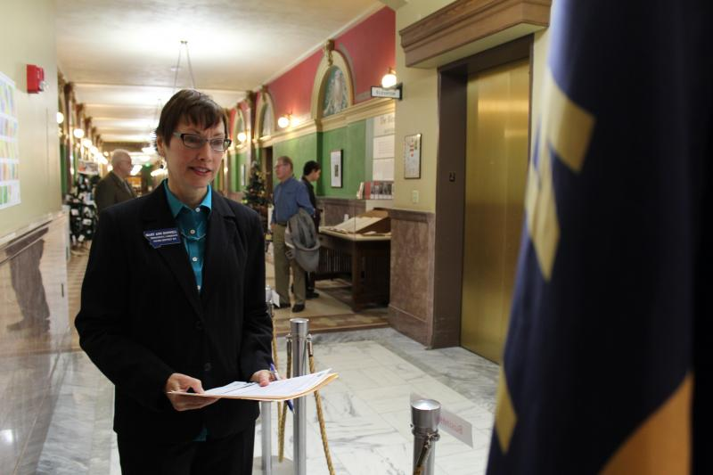Democratic State House Candidate Mary Ann Dunwell waits first in line moments before candidate filing begins at the Sec. of State's Office in Helena.