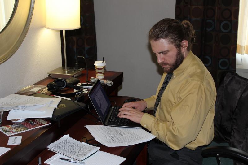 Capitol Reporter Dan Boyce hard at work in his hotel room.