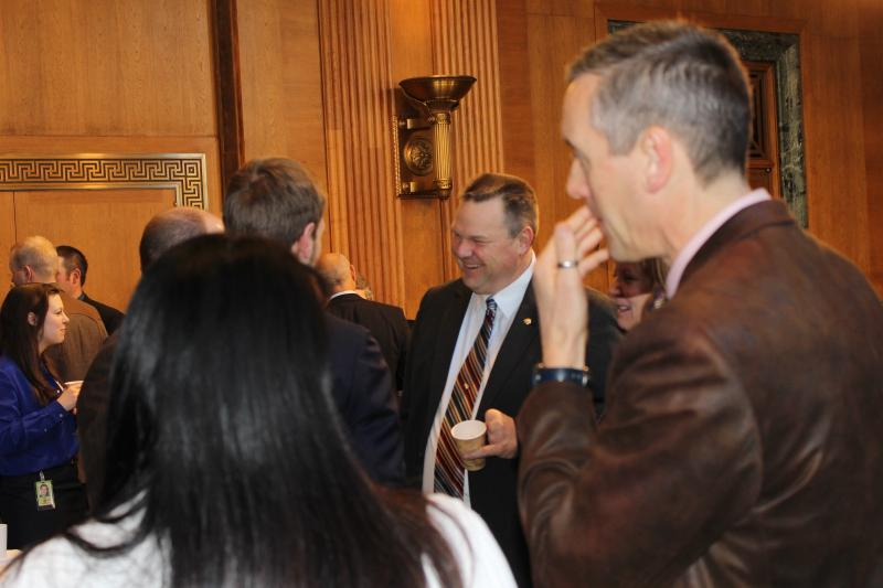 "Sen. Jon Tester speaking with visiting Montanans at a weekly ""coffee with constituents"" meeting in the Dirksen Senate Building."