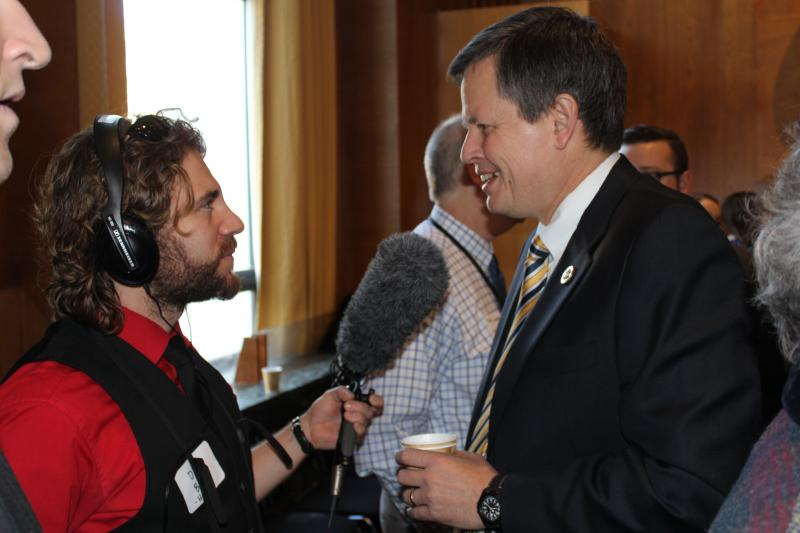 "Capitol Reporter Dan Boyce speaking with Rep. Steve Daines at the ""coffee with constituents"" event."