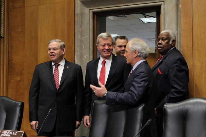 Sen. Max Baucus (D-MT), center, enters the Senate Foreign Relations Committee chamber with Sen. Robert Menendez (D-NJ), Sen. Jon Tester (D-MT), and Sen. Bob Corker (R-TN)