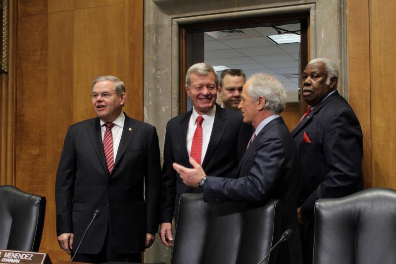 Sen. Max Baucus (D-MT), center, enters the Senate Foreign Relations Committee chamber with Sen. Robert Menendez (D-NJ), Sen. Jon Tester (D-MT), and Sen. Bob Corker (R-TN)