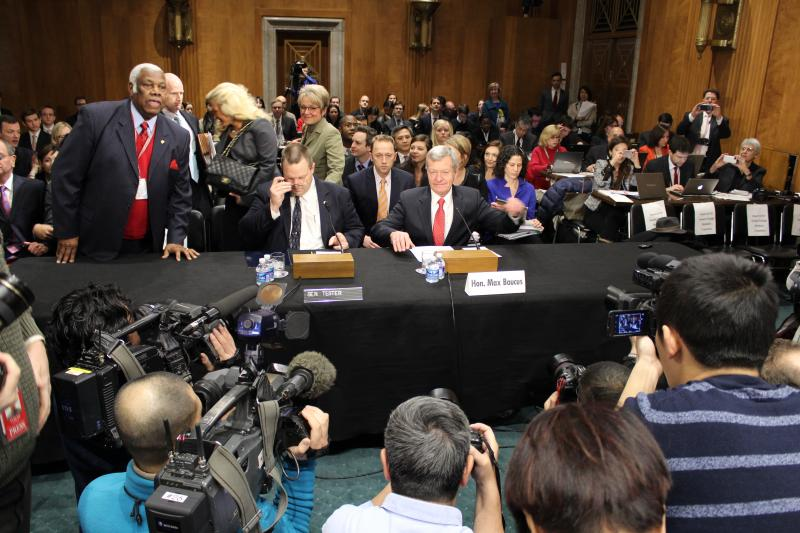 Senators Baucus and Tester prepare for opening comments during the Chinese ambassadorship confirmation hearing. The room was packed with both U.S. and Chinese journalists.