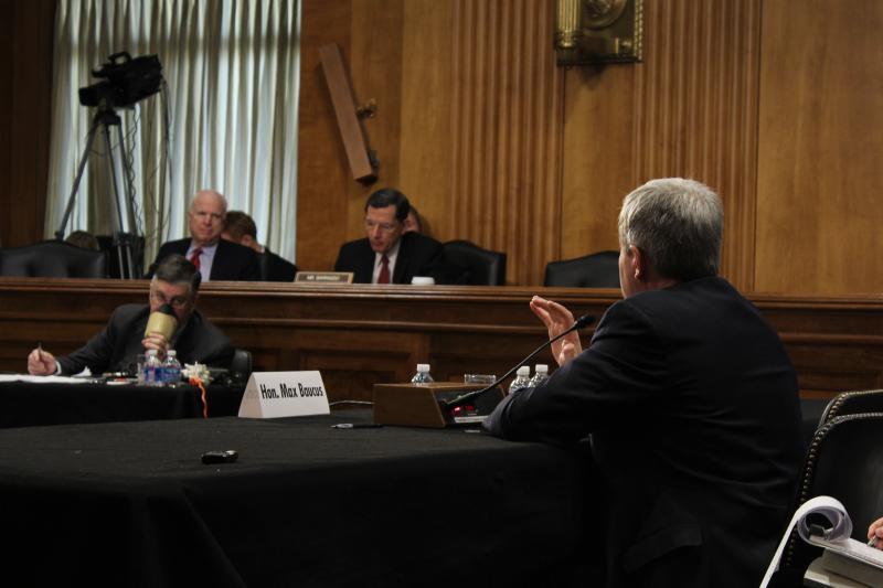 Sen. Baucus answering questions from Sen. John McCain (R-Arizona)