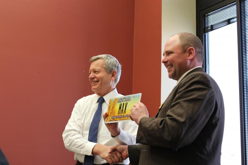 Sen. Max Baucus receives a specialized license plate from the Montana Grain Growers Association during what may be his last full week in office.