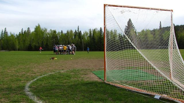Flathead Boys High School Lacrosse coach Matt Rizzolo gathers his team during practice.