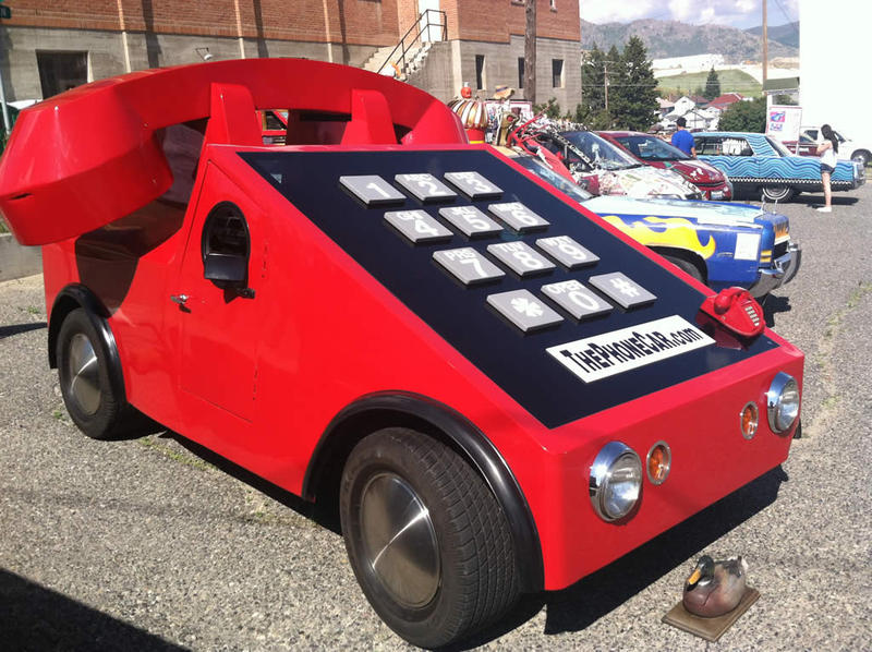 "Business owner Howard Davis originally created the ""Phone Car"" to promote his telephone company. Now the street legal art car travels from its home in Avon, Mass., to festivals and parades across the country."