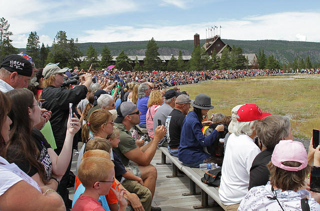 Tourists fill the bleachers at Old Faithful waiting for the geyser to erupt.