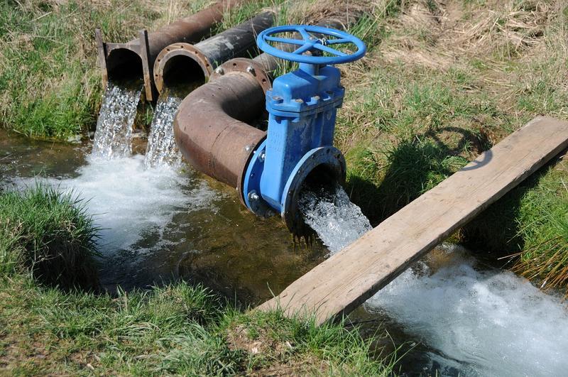 Pipes gushing water.