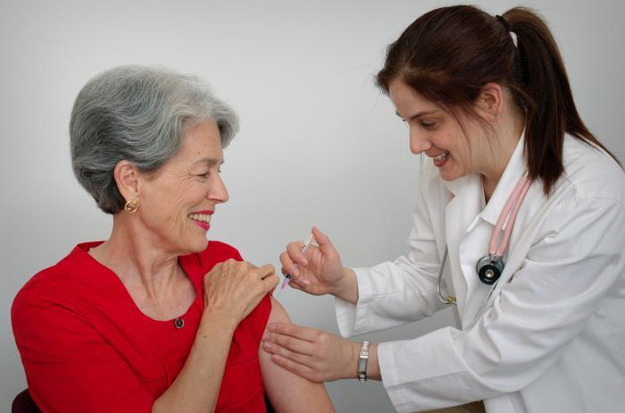 A woman gets the flu vaccine. File photo.