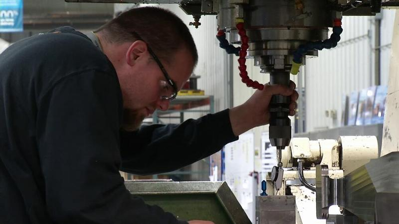 A Boeing worker operates a machine at the company's Helena, MT plant