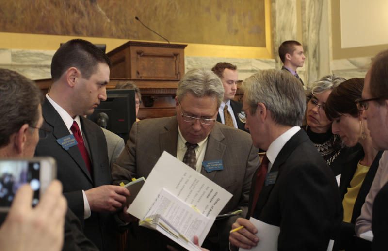 From left, House Speaker Austin Knudsen, R-Culbertson, Rep. Jeff Essmann, R-Billings, and Minority Leader Chuck Hunter, D-Helena, debate rules on the House floor April 8.