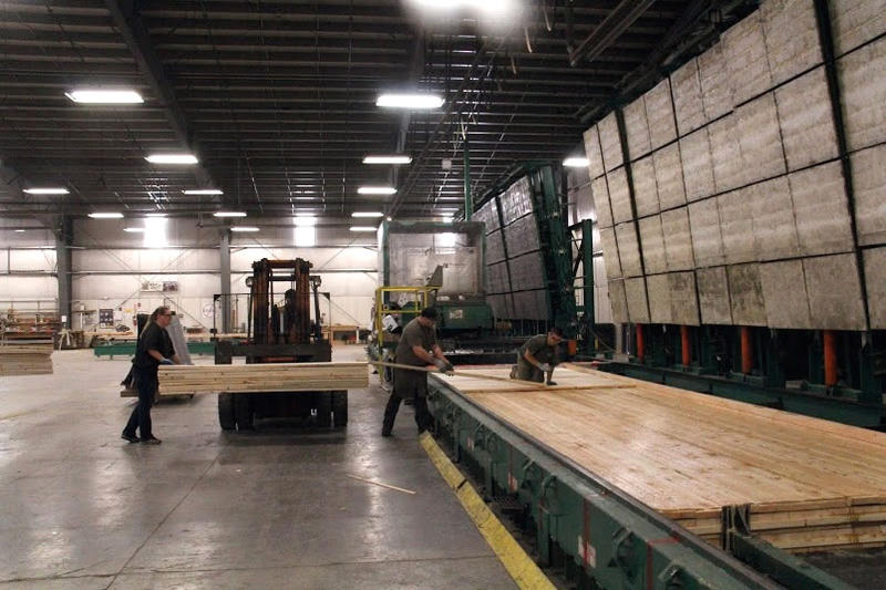 Workers at Smartlam's Columbia Falls plant work on cross-laminated timber or CLT.