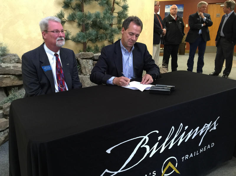 Rep. Mike Miller and Governor Steve Bullock at a ceremonial bill signing for House Bill 156, tax cuts for pollution control equipment, at the Billings-area Chamber of Commerce.