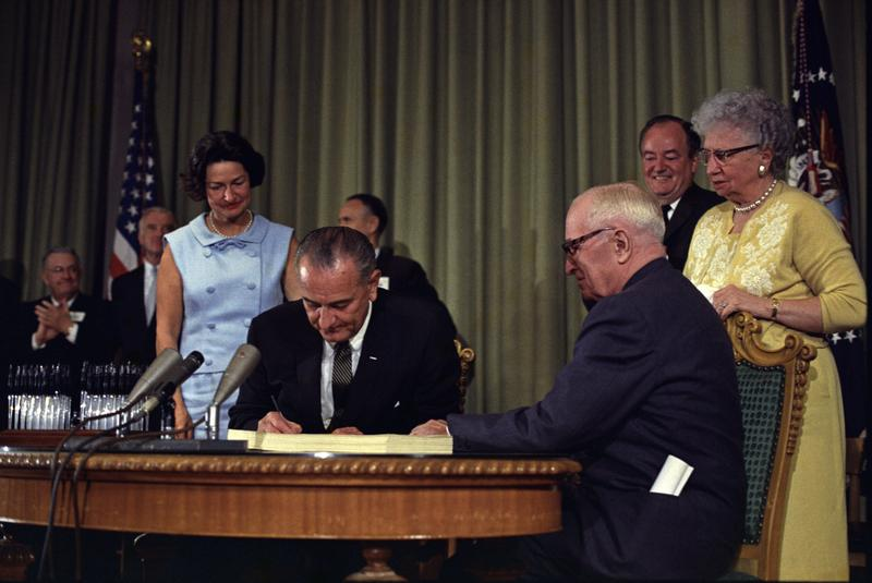President Lyndon B. Johnson signed the bill creating Medicare and Medicaid at the library of former President Harry Truman, who was in attendance, on July 30, 1965.