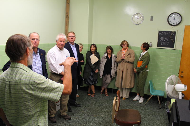 Committee members tour a former operating room in the MDC's old medical wing, which is now used to house communications equipment.