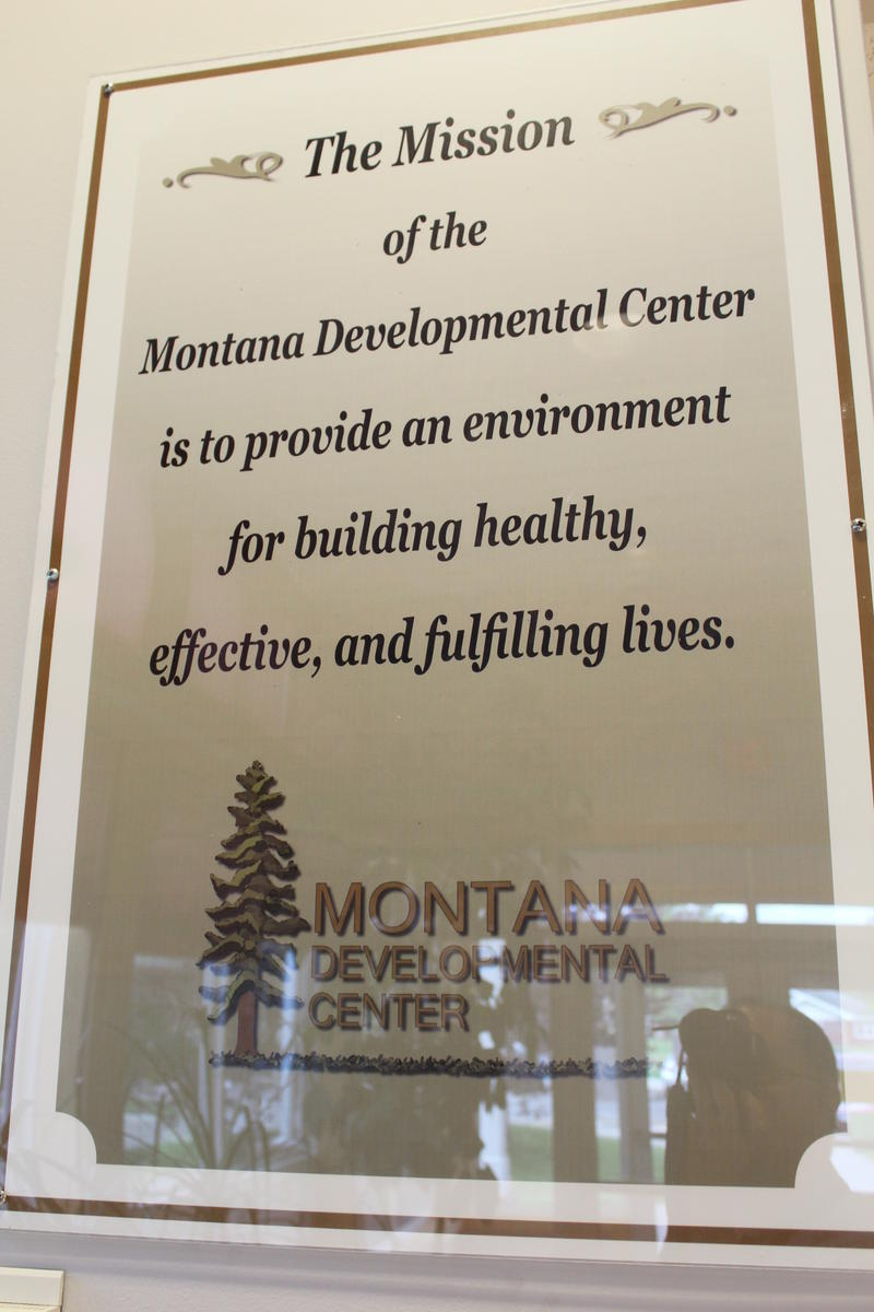 A plaque with MDC's mission statement hangs on the wall.