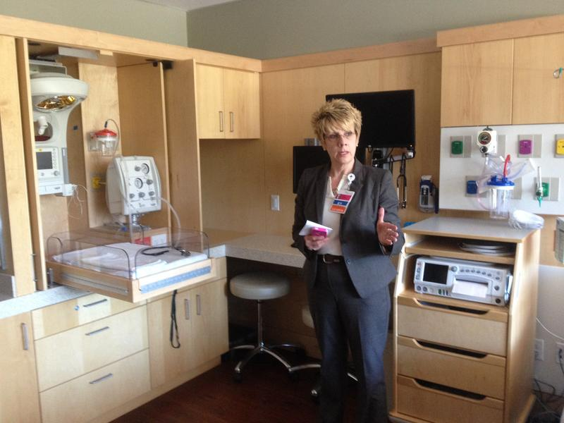 Kathy Schaefer, regional director of women's health for Providence shows one of the new labor and delivery rooms at St. Patrick hospital in Missoula.