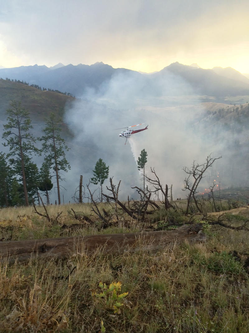 A helicopter on initial attack on the Burke Gulch fire this week, one of 40 lightning-caused wildfires crews have contained since Aug. 10.
