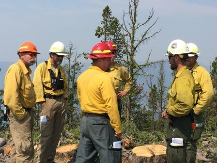 Firefighter planning meeting on the Scotchman's Gulch Fire.