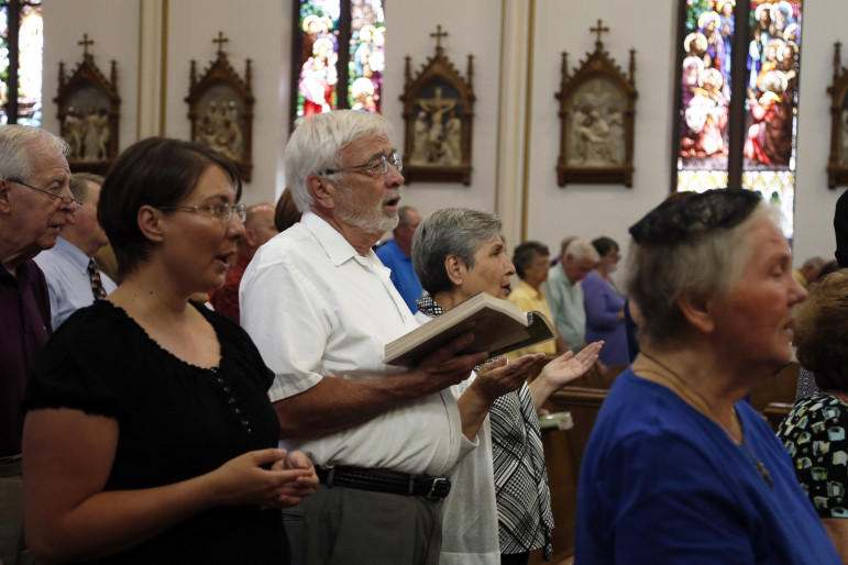 Congregants of Cheyenne, WY's Cathedral of St. Mary sing during Sunday Mass, June 21, 2015